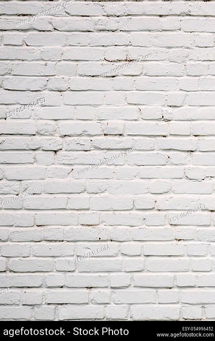 Background or texture of White Chipped Brick Wall