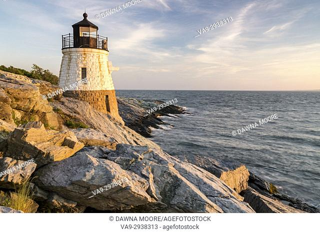 Castle Hill Lighthouse bathed in golden light in Newport, Rhode Island
