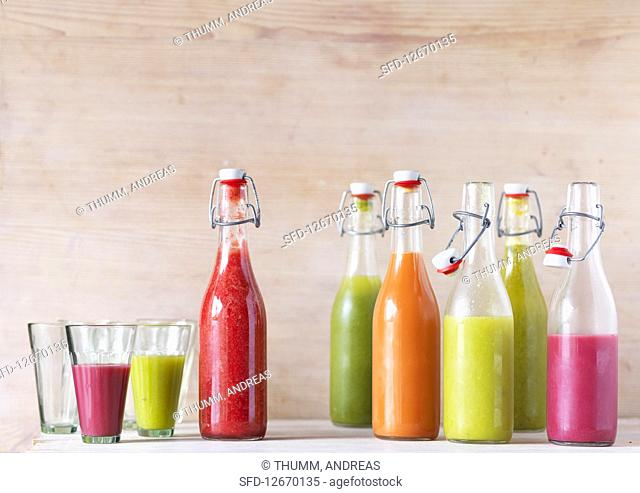 Various smoothies in bottles and glasses