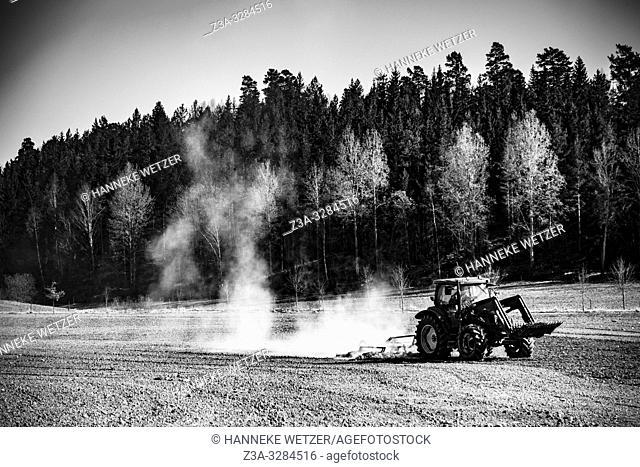 Tractor on field in Sweden