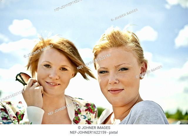 Portrait of two teenage girls smiling