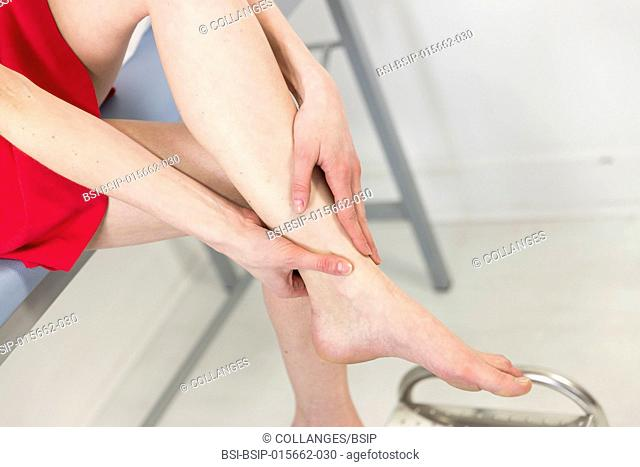 Female patient consulting for ankle pain