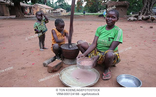 family in front of their house in central african republic