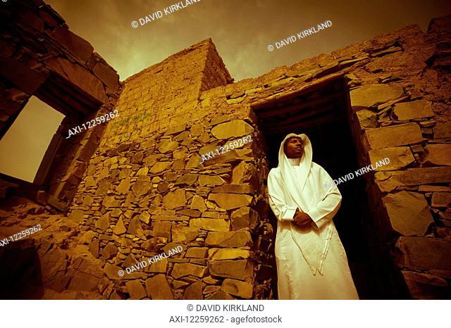 Moor Saudi standing in a doorway of old building; Taif, Saudi Arabia