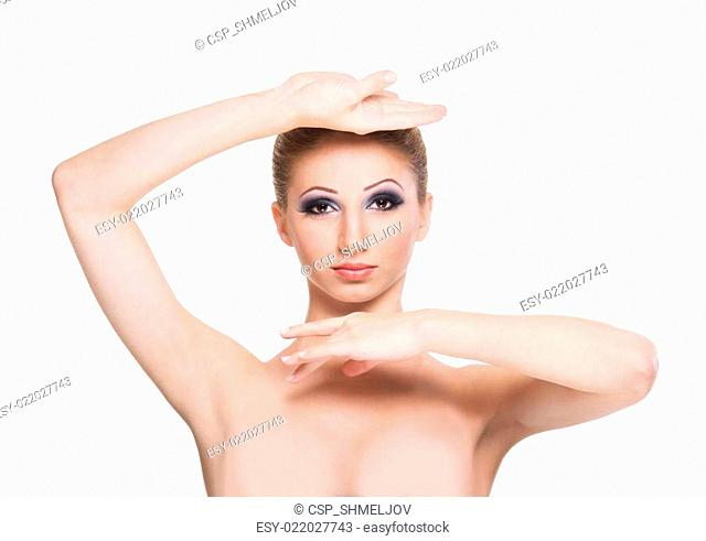 Portrait of a young and beautiful woman in makeup isolated on white