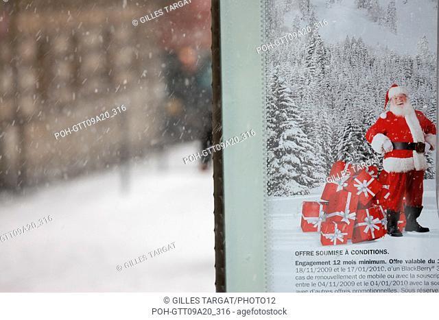 France, ile de france, paris 5th arrondissement, Snow, Snowy, Snowing, December 2009, Boulevard Saint Michel, Detail of an advertisement with Santa Claus Photo...