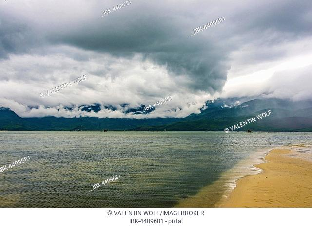 Sandy beach with dramatic stormy clouds in Hué, Thua Thien Hue, Vietnam