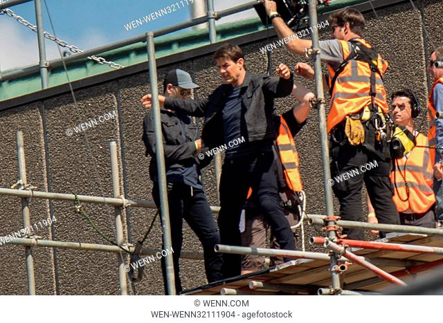 ?Tom Cruise leaps from the roof of one building to another while filming the next film in the 'Mission: Impossible' series; Cruise appeared to injure himself in...