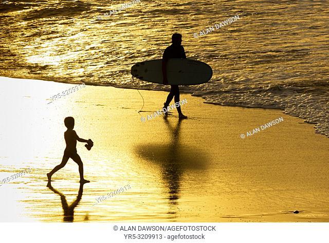 La Cicer, Playa de Las Canteras, Las Palmas, Gran Canaria, Canary Islands, Spain. Surfers at sunset on the city beach in Las Palmas