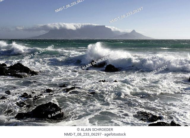 Waves breaking against rocks in the sea, Blaauwberg Strand, Cape Town, Western Cape Province, South Africa