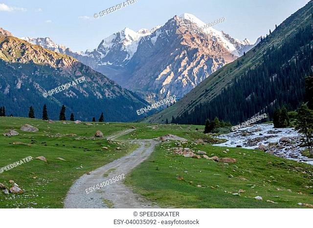 Dirt road and rapid Djuku river. Tien Shan mountains, Kirgizstan