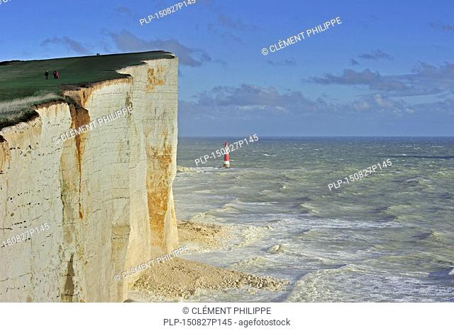View over the eroded white chalk cliffs and lighthouse at Beachy Head, Sussex in Southern England, UK