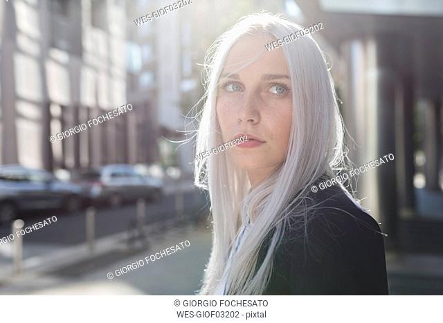 Portrait of young businesswoman in the city