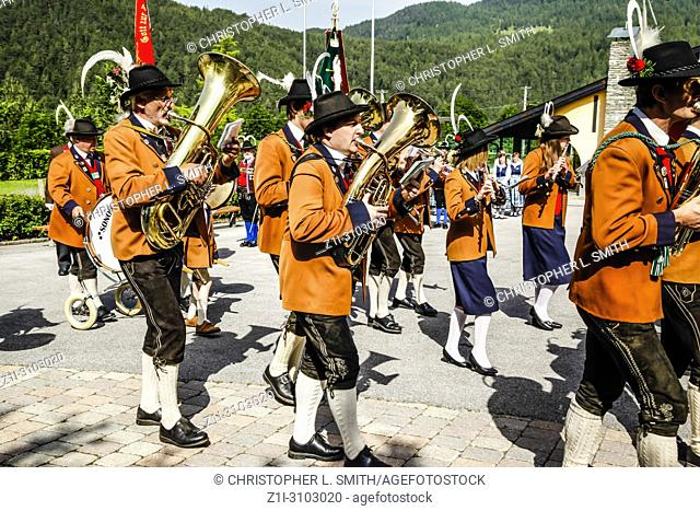 Local band members march out of the village square on Patronage day in Reith bei Seefeld, Austria