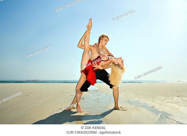 Couple dancing on a beach