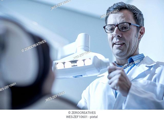 Dentist preparing treatment