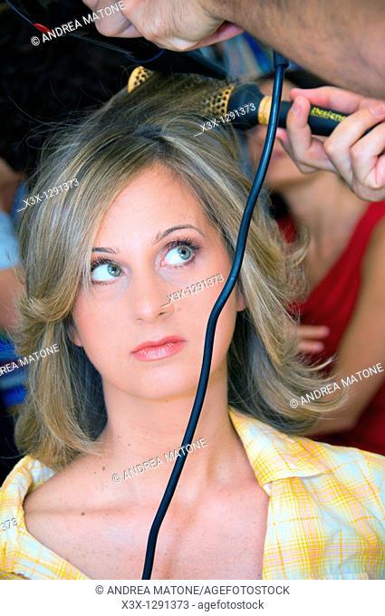 Woman getting her hair done at hair salon