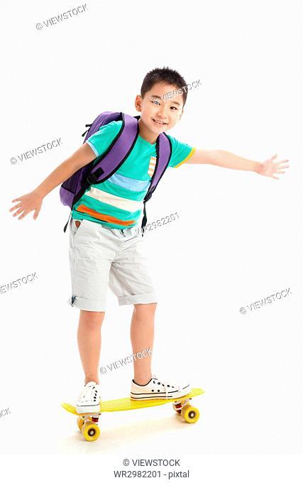 Portrait of boy with skateboard
