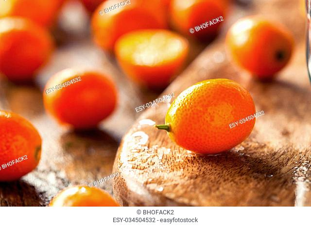 Raw Organic Orange Kumquats in a Bowl
