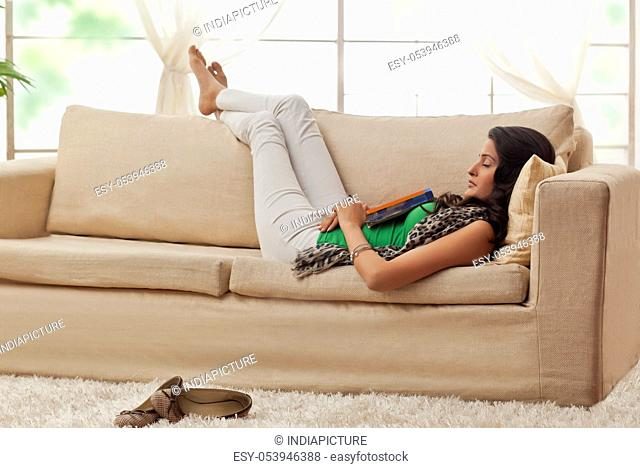 Woman resting on a sofa