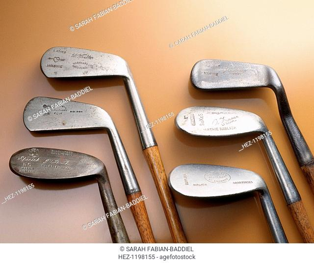 Selection of wood-shafted clubs, 1910-35. From left to right: mashie niblick, TJ Roach, Wellesby, hand-forged with lion cleek mark; mid iron, AH Scott
