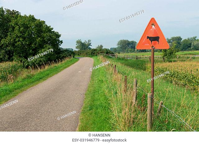 warning sign of cattle crossing a street in the netherlands