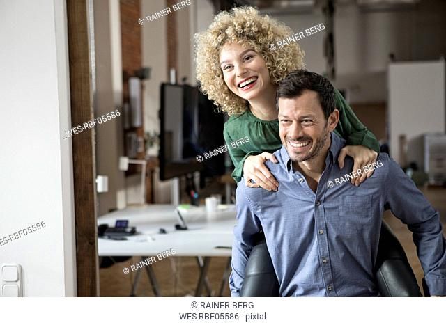 Carefree man and woman in office