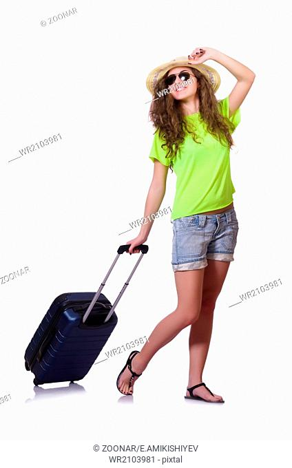 Young woman with suitcase on white