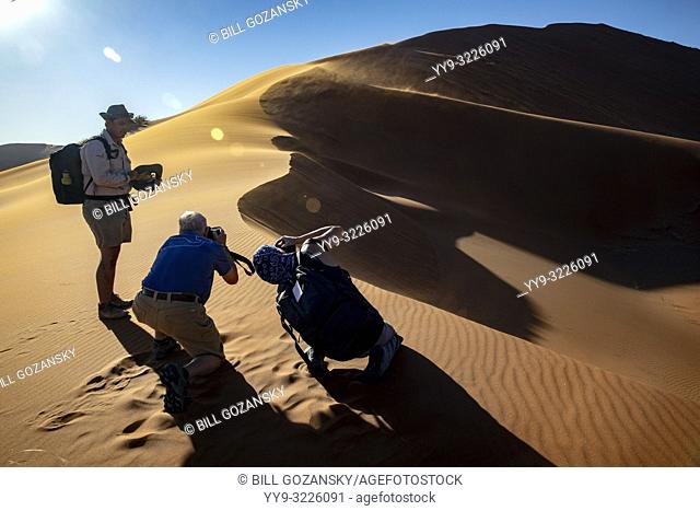 Photographers taking pictures of Elim Dune in Namib-Naukluft National Park, Namibia, Africa
