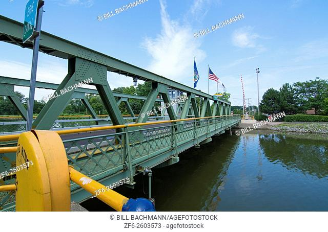 Brockport New York NY small town with famous historical Erie Canal with bridge over water for cars