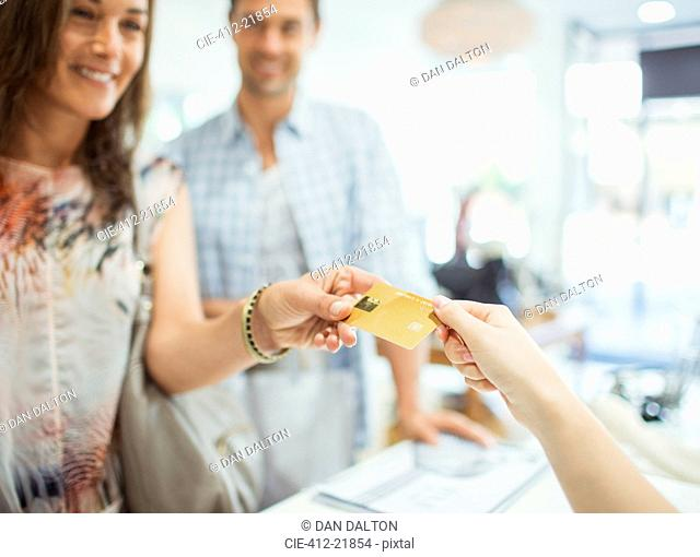 Close up of woman paying with credit card in store