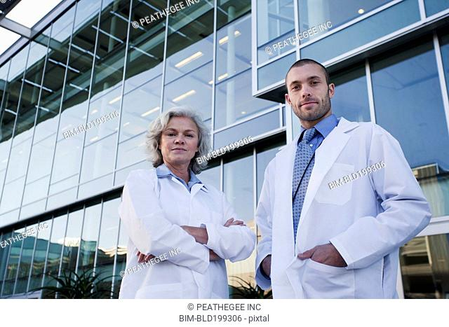 Serious doctors standing outdoors