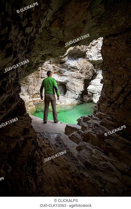 Man exploring the gorge of the Soffia waterfall, Mis valley, Dolomites, Belluno, Veneto, Italy, Europe