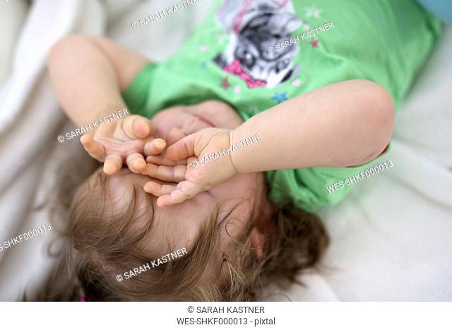 Baby girl rubbing eyes