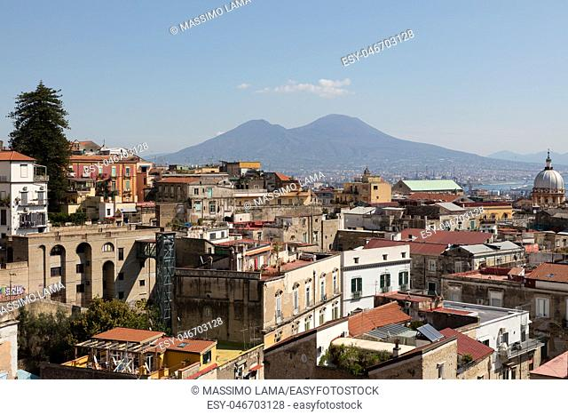 panorama of napoli with vesuvius,cloidds and buildings