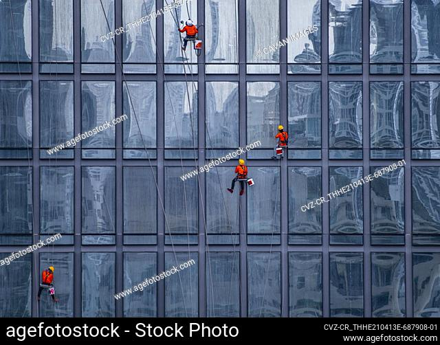 window cleaner's working on facade of high rise building in Bangkok