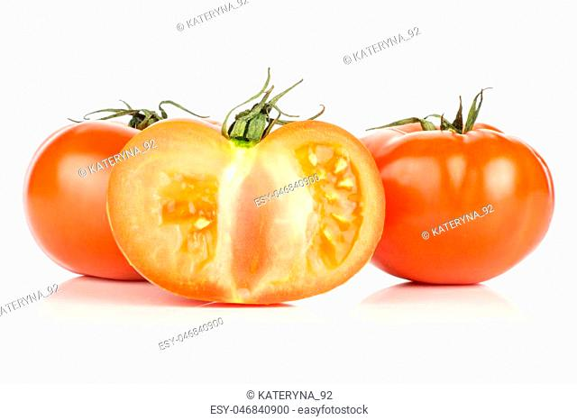 Red tomato section half and two whole with vine ends isolated on white background