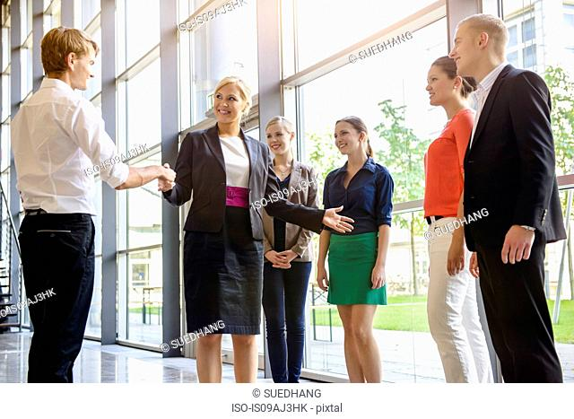 Businesswomen and men meeting client in office