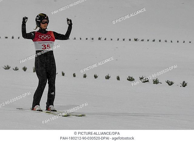Norway's Maren Lundby celebrates winning the gold medal during the women's ski jumping at Alpensia Ski Jump Centre during the Olympic Winter Games in...