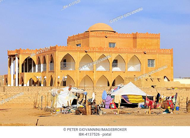 Nomad tent in front of a villa, Atar, Adrar Province, Mauritania