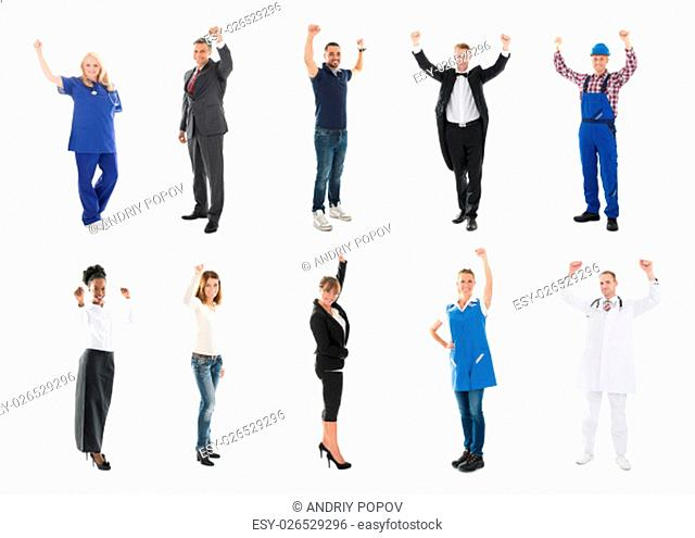 Full length portrait of happy medical team standing with arms raised against white background