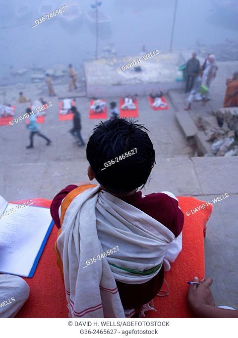 Children learning yoga on the ghats, Varanasi, Uttar Pradesh, India