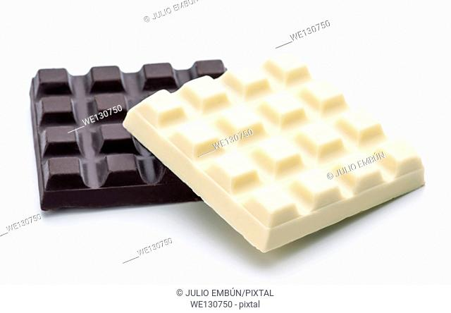 blocks of black and white chocolate isolated on white