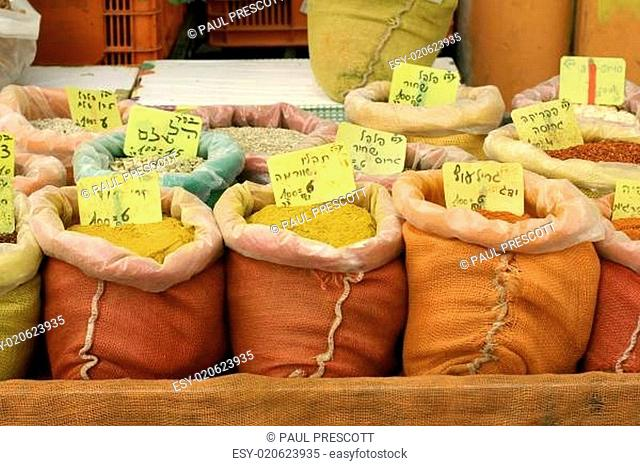 mixed spices on display in sacks on market