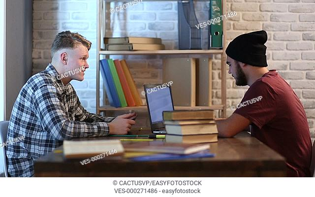 Hipster students studying in library at university