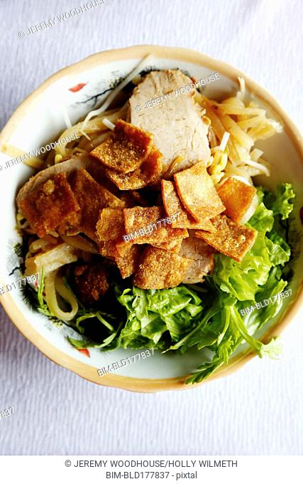 Bowl of meat, vegetables and noodles