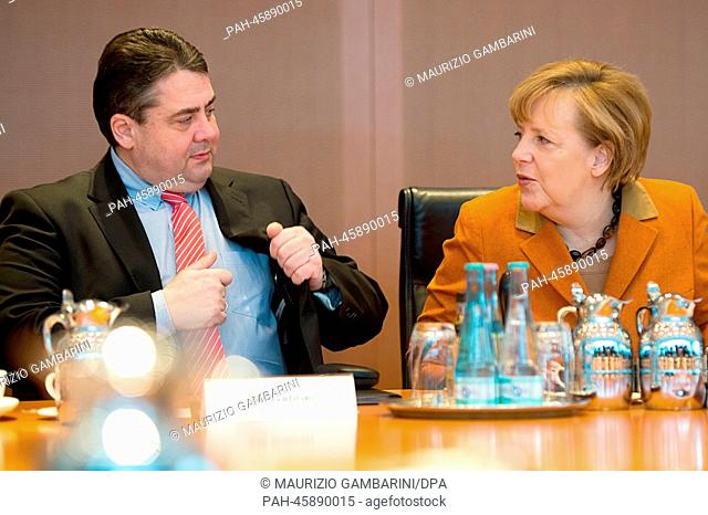 German Chancellor Angela Merkel (L) and Economics Minister Sigmar Gabriel take part in the German cabinet meeting in Berlin, Germany, 29 January 2014