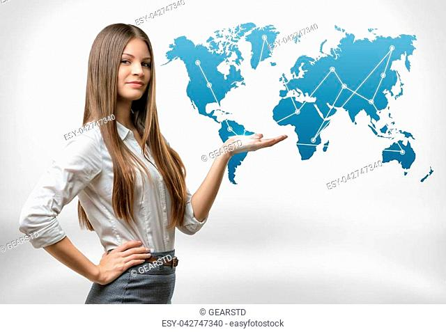 Cropped portrait of young businesswoman raised her hand presenting world map. Global communication. International relations. Business staff