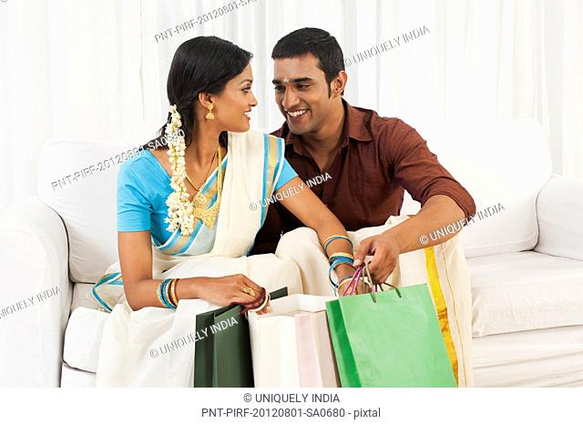 South Indian couple carrying shopping bags