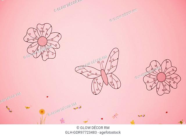 Flowers and a butterfly drawn on a wall